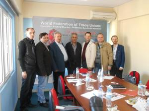 Генеральный секретарь ВФП Георгиос Маврикос с делегатами «Жанарту»